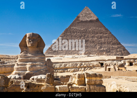 The Pyramid of Khafre, also known as Chephren, and the Sphinx at the necropolis on the Giza plateau near Cairo, - Stock Photo