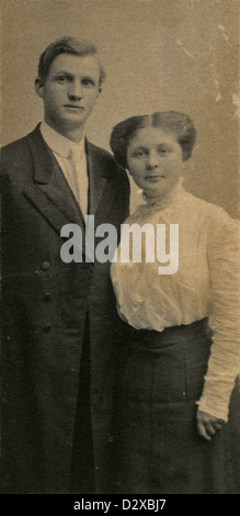 Circa 1890s photograph, Victorian husband and wife in period dress. - Stock Photo