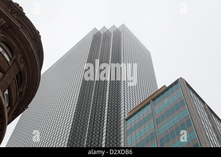 View from below of the tops of three buildings of varying ages in Dallas, Texas. - Stock Photo