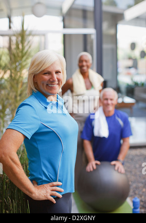 Older friends exercising together - Stock Photo