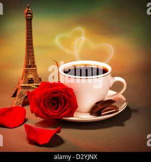 Conceptual photo of romantic trip to France, beautiful morning in Paris, food still life, cup of coffee with piece - Stock Photo