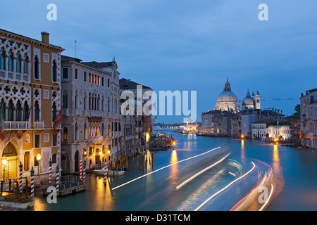 Light streaks on Grand Canal and Santa Maria della Salute Church, Venice, Italy - Stock Photo