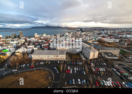 Daylight View over colourful Reykjavik rooftops from Hallgrímskirkja church in iceland using wide angle lens with - Stock Photo