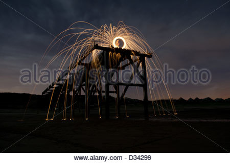 Wire wool spinning used a light painting technique on top of the cut off Steetley pier, Hartlepool,UK - Stock Photo