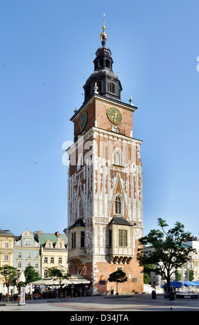 Town hall tower with clock on the Main Market Square (Rynek) in Cracow, Poland - Stock Photo