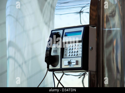 The public phone in Dubai International Airport - Stock Photo