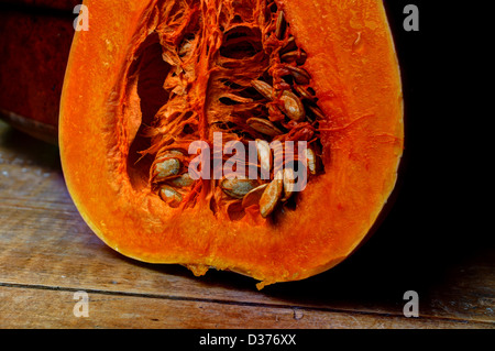 Butternut, halved showing seeds - Stock Photo
