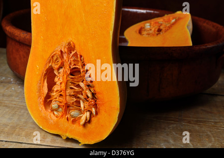 Butternut, halved showing seeds in baking tien - Stock Photo
