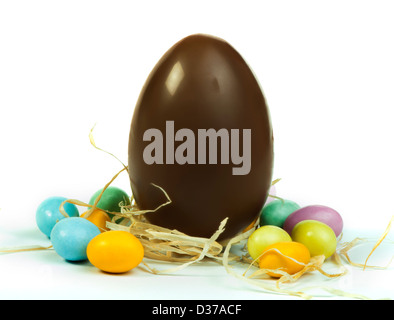 Chocolate Easter Egg and small multicolored eggs white isolated. - Stock Photo