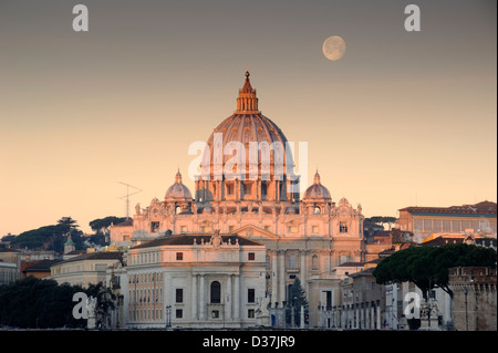 italy, rome, st peter's basilica at dawn with the moon setting over the dome - Stock Photo