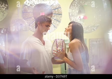Arguing couple shopping in store - Stock Photo