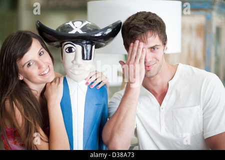 Smiling couple shopping in store - Stock Photo