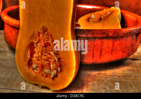 Halved butternut squash showing seeds in baking tien - Stock Photo
