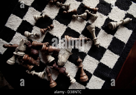 Game pieces on furry chess board - Stock Photo