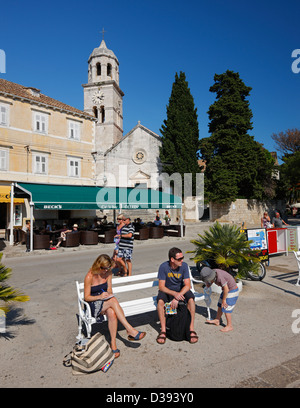 Tourists sitting on bench in old town Cavtat in Croatia - Stock Photo