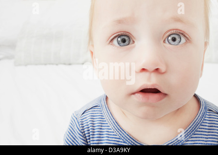 Close up of baby girls surprised face - Stock Photo
