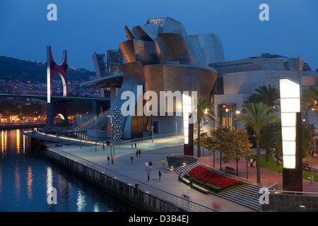 The Guggenheim Museum and the river front at night, Bilbao, Biscay, Spain, Basque country. - Stock Photo
