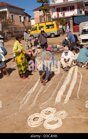 Madagascar, Ambositra, Marche Sandrandahy market, customers at sisal rope stall - Stock Photo