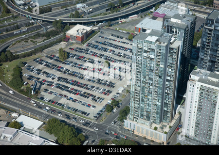 Aerial elevated view of Car Park next to office building and residential apartment buildings South Melbourne Victoria - Stock Photo