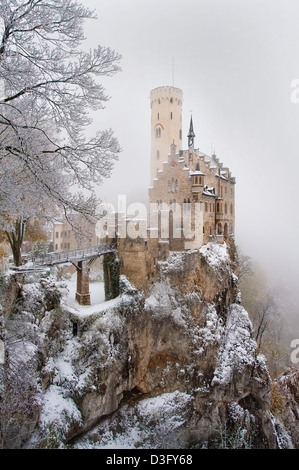 The beautiful and romantic Schloss Lichtenstein in the Swabian Alps, Germany sits perched on a precipice on a cold - Stock Photo
