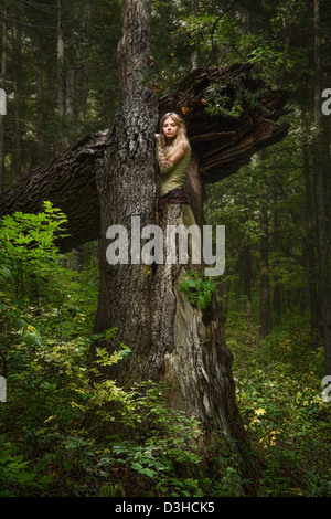Blond girl in a magic forest - Stock Photo