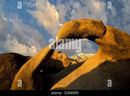 Arch and Lone Pine Peak framed with moon. Alabama Hills, California - Stock Photo