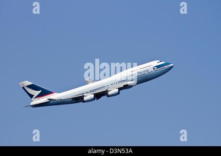 Cathay Pacific Jumbo Jet after take off at Haneda Airport, Tokyo, Japan - Stock Photo