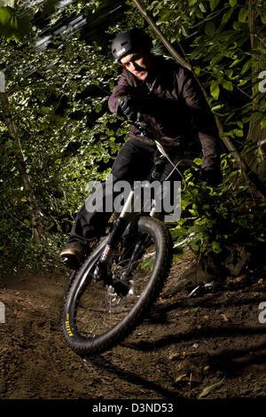 Downhill mountain biking determination, Esher forest, England - Stock Photo