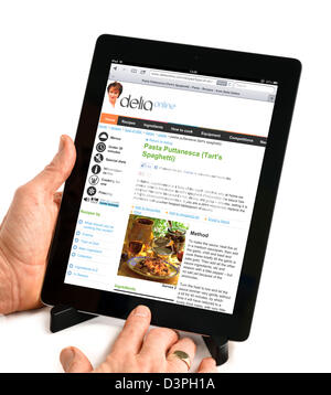 Viewing a Delia Smith recipe at the deliaonline.com website on an iPad - Stock Photo