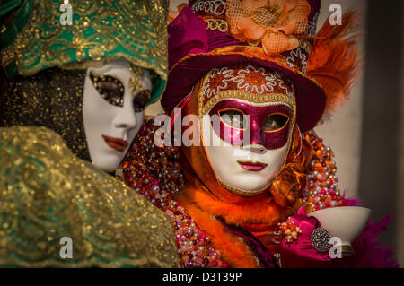 Two women dressed up for the Carnival in Venice, Italy, Europe - Stock Photo