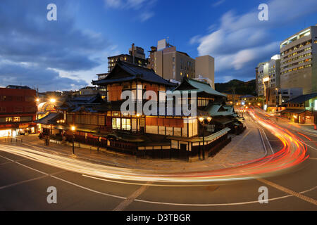 Dogo Onsen and the cityscape of Matsuyama, Japan. Dogo Onsen is one of the most famous hot spring bath houses in - Stock Photo