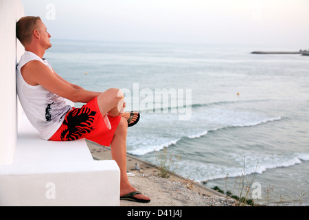 Man relaxing on the beach Albufeira in Portugal - Stock Photo