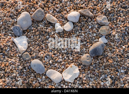 heart shape made of pebbles on a beach - Stock Photo