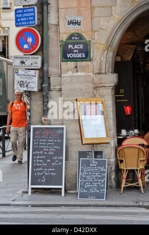 Menus on display outside French restaurant, Paris, France. - Stock Photo