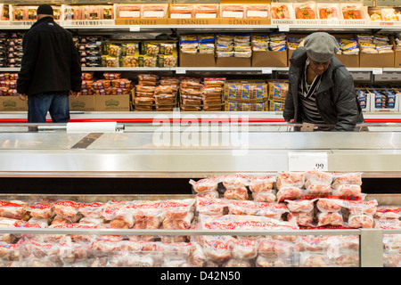 Costco wholesale warehouse club in san jose california stock photo customers shopping in the meats section of a costco wholesale warehouse club stock photo thecheapjerseys Images