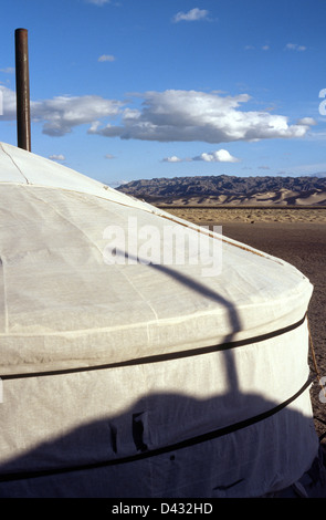 Sunrise at a ger (yurt) camp at the sand dunes of Khongoryn Els in the Gobi desert's Gurvansaikhan National Park - Stock Photo