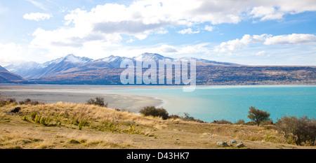 Beautiful panorama scenery Tasman turquoise lake in autumn Mt Cook national park southern Alps mountain valleys - Stock Photo