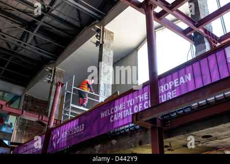 A workman at the main railroad station of Kosice, in eastern Slovakia, working on March 4, 2013, to renovate the - Stock Photo
