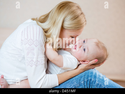 mother playing with baby boy isolated on white - Stock Photo