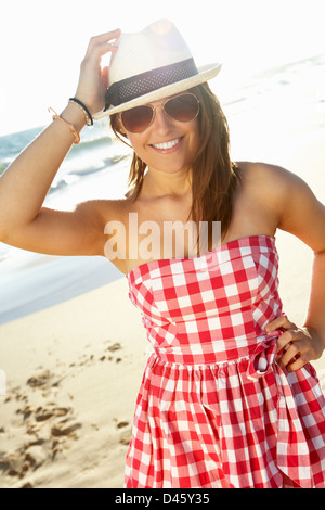 Attractive Teenage Girl Wearing Dress On Beach Holiday - Stock Photo
