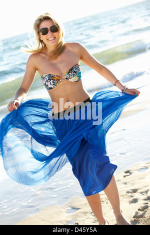 Teenage Girl Wearing Sarong On Beach Holiday - Stock Photo