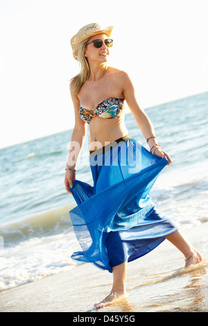 Teenage Girl Wearing Sarong On Beach Holiday - Stockfoto
