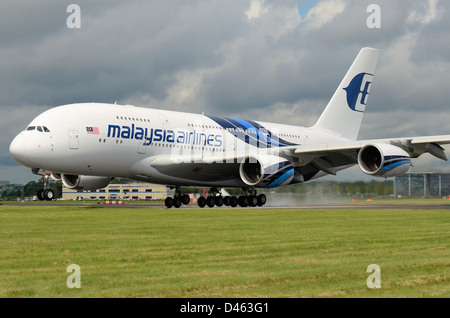 A Malaysia Airlines Airbus A380 'Super Jumbo' lands at Farnborough International Airshow after displaying during - Stock Photo
