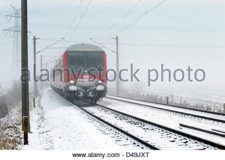 Oeversee, Germany, regional train in winter - Stock Photo
