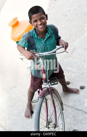 Happy young indian street boy with his bicycle. Andhra Pradesh, India - Stock Photo