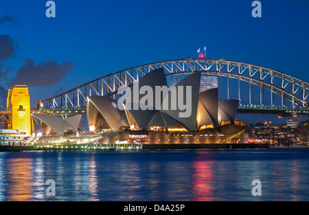 View Sydney Opera House and Harbour Bridge at night in Australia - Stock Photo