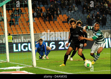 Sporting Clube de Portugal player Carrillo vies for the ball with Academica defender Rodrigo Galo during a Portuguese - Stock Photo