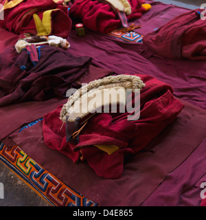 China, Xizang, Lhasa, Drepung Monastery, Monk's clothing - Stock Photo