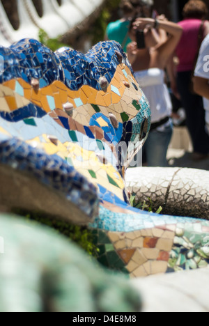 People taking pictures and posing at the Gaudi's Lizard fountain, Park Guell, Barcelona, Spain - Stock Photo
