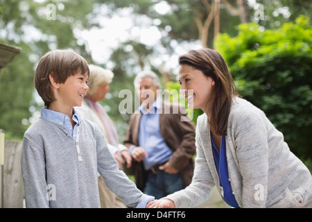 Mother walking with son outdoors - Stockfoto